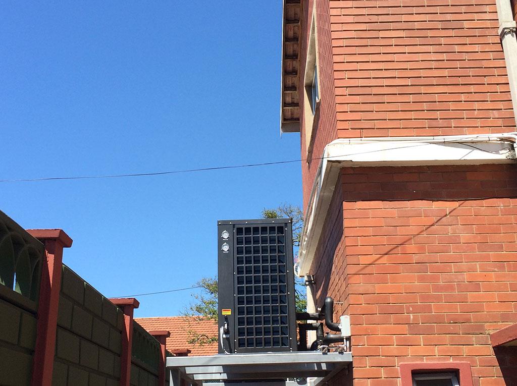 Glenwood Boys installation of TKRS 450E N2 M Heat Pump Side View 2