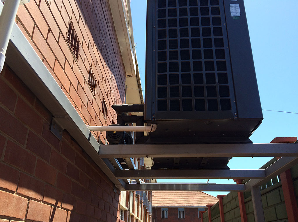 Glenwood Boys installation of TKRS 450E N2 M Heat Pump Side View
